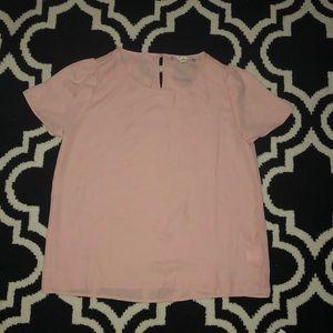 A light pink blouse
